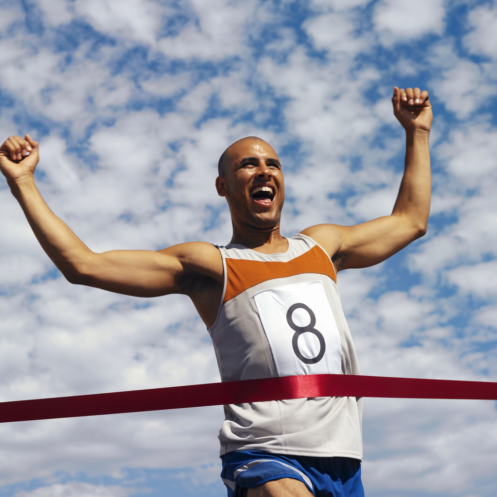 Man Running Reaching Finish Line