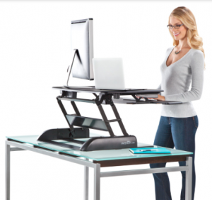 This workstation by Varidesk is adjustable so the user can sit or stand.